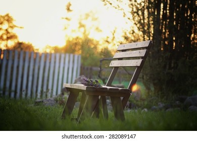 bench on the lawn in the village
