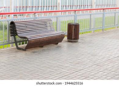 Bench on the railway platform. A modern bench on a railway platform.