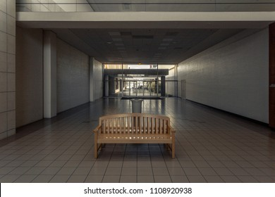 Bench on tile floor in empty mall