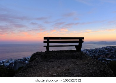 A bench overlooking Cape Town at sunrise