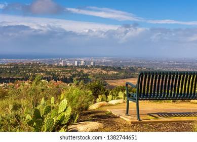Bench overlooking Huntington Beach and Newport Beach located at the Vista Ridge Park in California