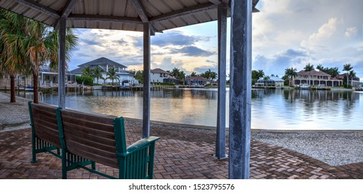 Bench overlooking Savage Pass, which flows under Savage Bridge, at the entrance of Marco Island, Naples, Florida