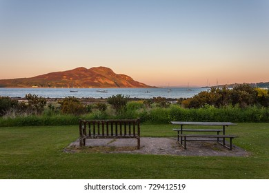 Bench and Picnic Table looking out to Sea and Island at Sunset. Lamlash, Arran, Scotland.