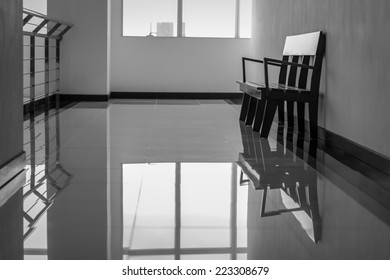 bench with reflection on the floor