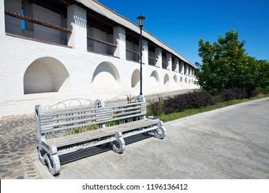 Bench for rest on the background of the fortress wall
