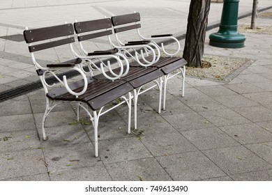 bench for rest, on the sidewalk