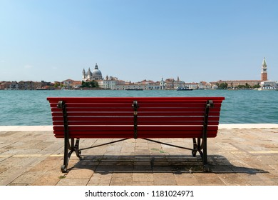 Bench for rest in Venice with view on canal and old town