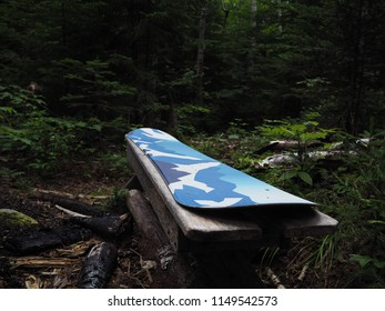 A bench with a snowboard attached to it on Wildcat Mountain in NH.