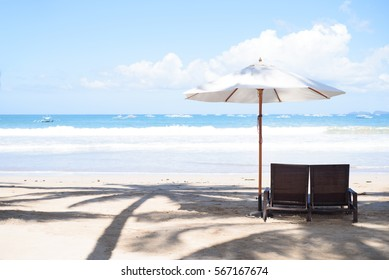 Bench and umbrella at the beach.