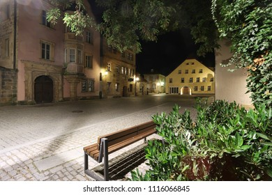 bench under light of lantern, dark old street covered cobblestone of  ancient Bavarian town - Bayreuth, Upper Franconia, Bavaria, Europe, Germany, wallpaper night townscape