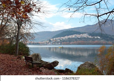 Bench with view  reflections on the lake and districts of town Kastoria in Greece