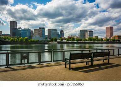 Bench and view of the skyline from the Eastbank Esplanade, in Portland, Oregon.
