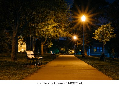 Bench and walkway at Federal Hill Park at night, in Baltimore, Maryland.