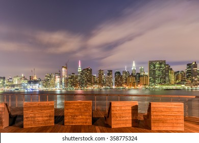 Benches along Gantry Park with the New York City skyline view in the background.