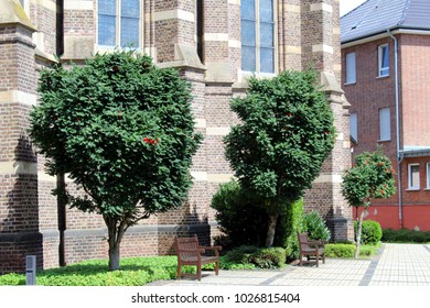 Benches and Cross in front of the Roman Catholic Church St. Lambert in Bedburg