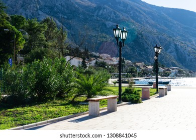 The benches at the embankment of the Kotor bay. Kotor, Montenegro