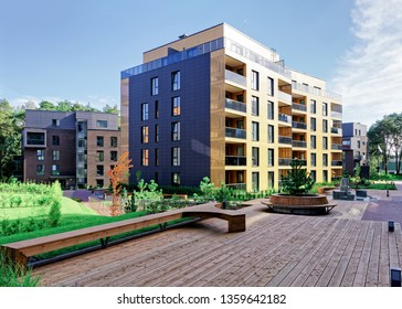 Benches at Modern complex of apartment residential buildings. And outdoor facilities.