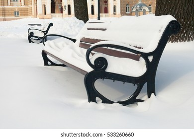 Benches in a Park covered with snow.
