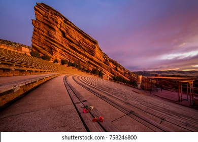 benches at red rocks amphitheater in denver colorado with carnation flowers