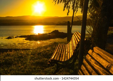 Benches to watch the sunset on Pazo beach in Rianxo town, Arousa estuary in Galicia