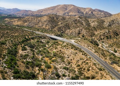 Bend in a highway in the hills of the desert of the American southwest.