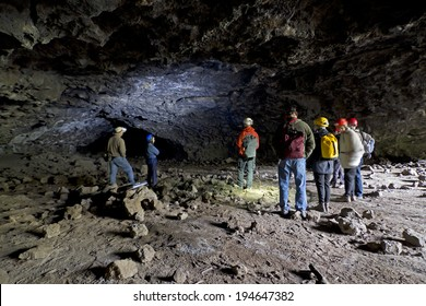 BEND, OR - May 10: Group of  people doing cave study in lava tube cave in Bend, OR  May 10, 2014