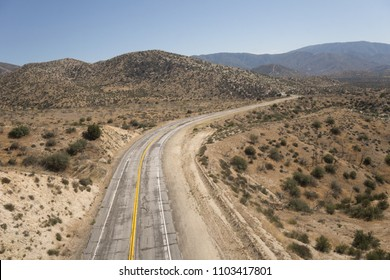 Bend in an old abandoned desert road in the wilderness of the Mojave Desert of California.