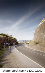 bend in road build into a mountain in spain