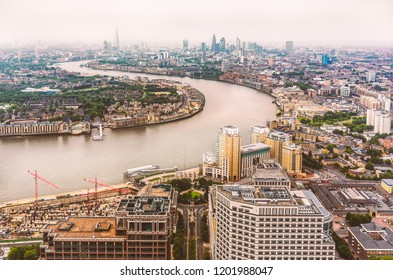 The bend in the Thames river and the London skyline on a misty late afternoon in June 2013