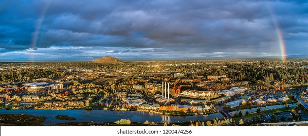 Bend, OR / USA - 10-09-2018: An aerial view of the Old Mill District in Bend, Oregon with a beautiful rainbow