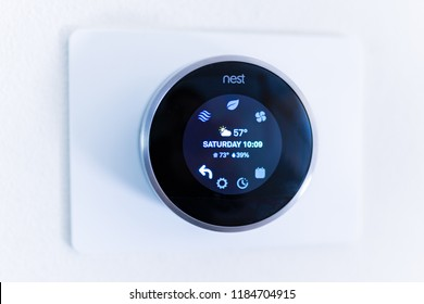 Bend, OR / USA - September 1, 2018: Nest learning thermostat on the wall.