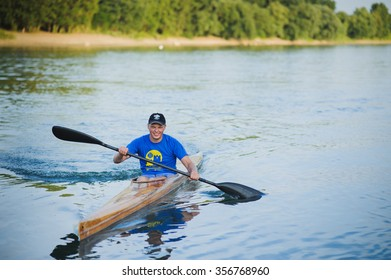 Bendery,Pridnestrove,June 18-19,2015 competition of rowing.Open Championship Pridnestrove rowing.Sportsmen in sport kayaks paddles on the water.