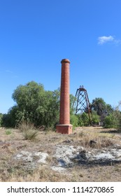 BENDIGO, AUSTRALIA - February 25, 2018: The North Deborah Gold Mine (1937-1954) poppet head and chimney are the only visible surface remains at the site