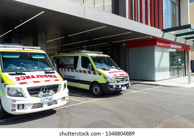 Bendigo, Australia - October 28, 2018: Ambulance Victoria Mercedes Sprinter vans outside the emergency department at the Bendigo Hospital.