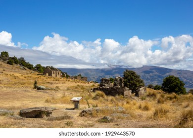 Bendigo, Central Otago, New Zealand, December 20 2020: The remains of stone houses in a deserted gold town attract tourists and those interested in New Zealand gold rush history