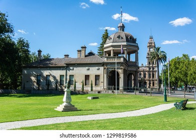 Bendigo, Victoria, Australia - February 27, 2017. View of Soldiers Memorial and monument to late Australian politician and author Sir John Quick in Queen's Garden in Bendigo, VIC.