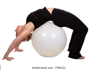 Bending backwards over exercise ball in gym