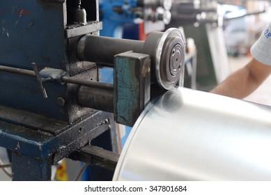 bending,Worker at manufacture workshop operating cidan folding machine,sheet metal work