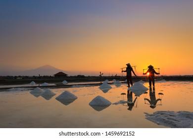 Bendungan. Cirebon, Juli 23. 2019 :The activity of farmer working on salt / Aktivitas petani garam