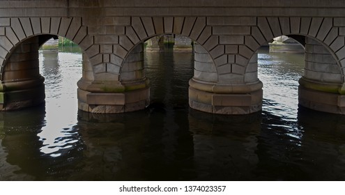 Beneath the road and railway bridges that cross the river Clyde in Glasgow Scotland