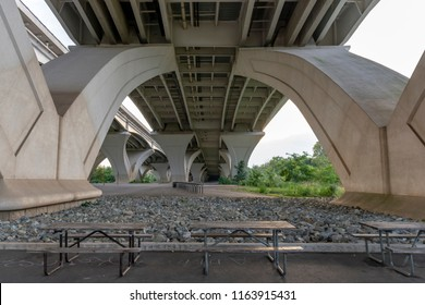 Beneath the Woodrow Wilson Memorial Bridge, which spans the Potomac River between Alexandria, Virginia, and the state of Maryland, as seen from Jones Point Park in Alexandria.