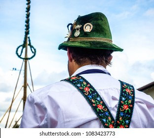 BENEDIKTBEUERN, GERMANY - MAY 1: A traditional maypole is being set up by the local bavarians during the typical May Day festival on May 1, 2018 in Benedikteuern in Germany.