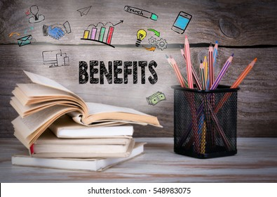 Benefits, Business Concept. Stack of books and pencils on the wooden table.