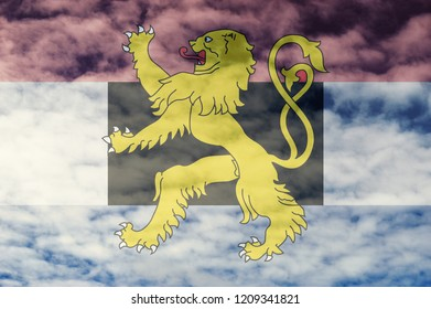 Benelux countries flag with cloud sky background.