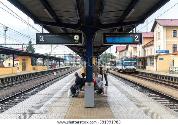 BENESOV, CZECH REPUBLIC - 2 august 2016: Benesov u Prahy railway station. Passenger platform with a roof, placards with the schedule of trains and passengers.