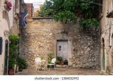 Benevento, Campania / Italy - 07 20 2018: A small square in the middle of Benevento invites to sit down and enjoy a peaceful moment. A sign says 'Bed & Breakfast Le Streghe ('the witches').