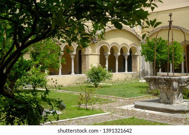Benevento, Campania / Italy - 07 21 2018: The Santa Sofia cloister in Benevento is a romanesque masterpiece and has a peaceful garden that you can see while visiting the 'Museo del Sannio'.