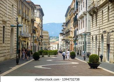 Benevento, Campania / Italy - 07 21 2018: 'Corso Garibaldi' is the main road of the historical center of Benevento and forms the heart of the city. In the background lie the hills of the countryside