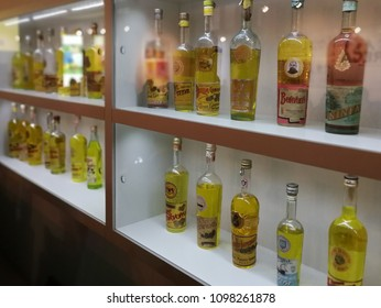 "Benevento, Campania, Italy - 23 May 2018: The over 400 counterfeit bottles found from all over the world, trying to emulate the Liquore Strega, on display at the ""Spazio Strega"" museum at the Alberti"