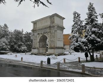 Benevento, Campania, Italy -26 February 2018: Arco Traiano seen from via del Pomerio after an unusual snowfall